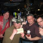 trivia night winners make faces after trivia night at Macky's