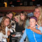 a group of ladies pose with their pooch at macky's dog friendly bar