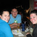 three people with drinks at trivia night at macky's bayside