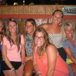 A group of girls pose for a picture at mackys Outside dining Ocean City MD