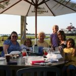 a family sits outside at a restaurant in ocean city md