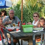 a family sit outside at dinner at Macky's Restaurant in Ocean City