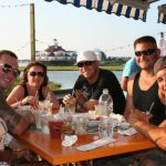 A party of friends sit outside at Macky's Restaurant Ocean City MD